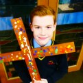 pupil with a church cross