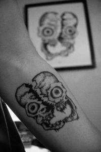 Cleaved Skull Tattoo