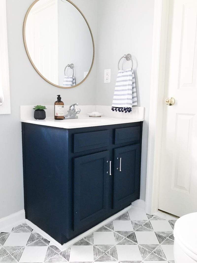 One Room Challenge: Guest Bath Reveal in Williamsburg, VA from StampinFool.com Modern Navy and White Bathroom Renovation including DIY painted vanity, painted vinyl floors and mixed metals.