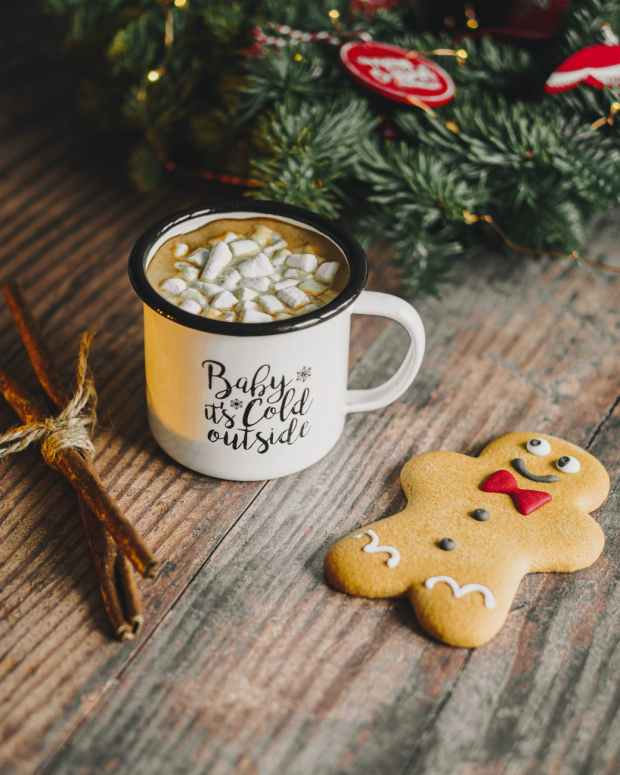 gingerbread man near coffee mug