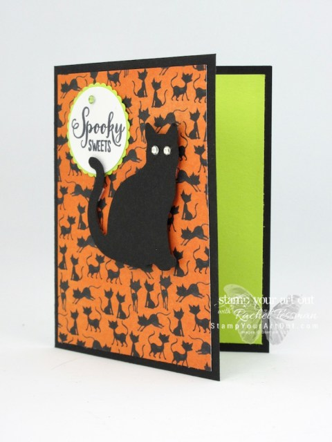 Click here to see how I made a fun Kit Kat treat box with coordinating card using Stampin' Up! products from the 2018-19 Annual Catalog (the Cat Punch, Rhinestones, & Mini Pizza Boxes) and the 2018 Holiday Catalog (Toil & Trouble Designer Paper, Spooky Sweets Stamp Set & Black Glittered Organdy Ribbon)…#stampyourartout #stampinup - Stampin' Up!® - Stamp Your Art Out!