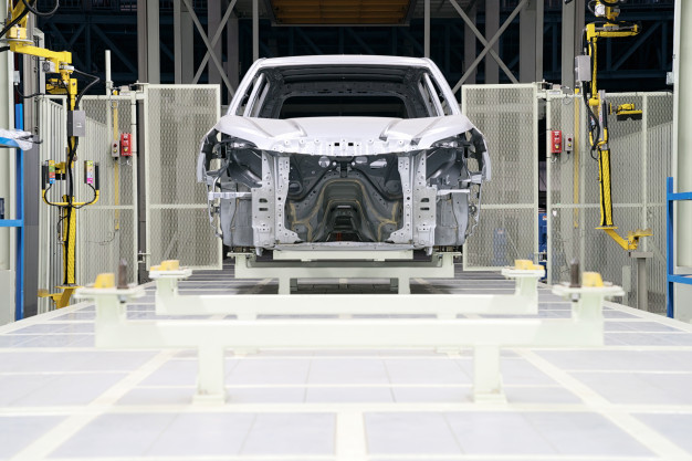 car-frame-with-unfinished-assembly-production-line-automobile-enterprise_40936-175