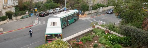 An Israeli bus-driver in a tandem begins an artful U-Turn