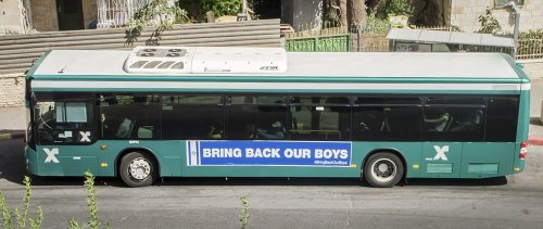 bus with sign, bring back our boys