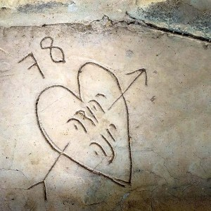 Names Yehuda and Yona inscribed in horse barn's concrete footer.