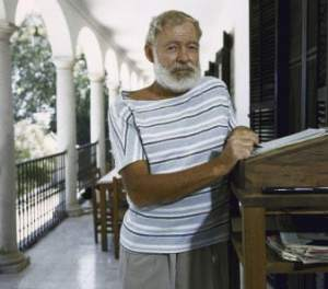Ernest Hemingway working at a standing desk