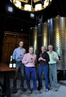 Photo of four people holding wine glasses