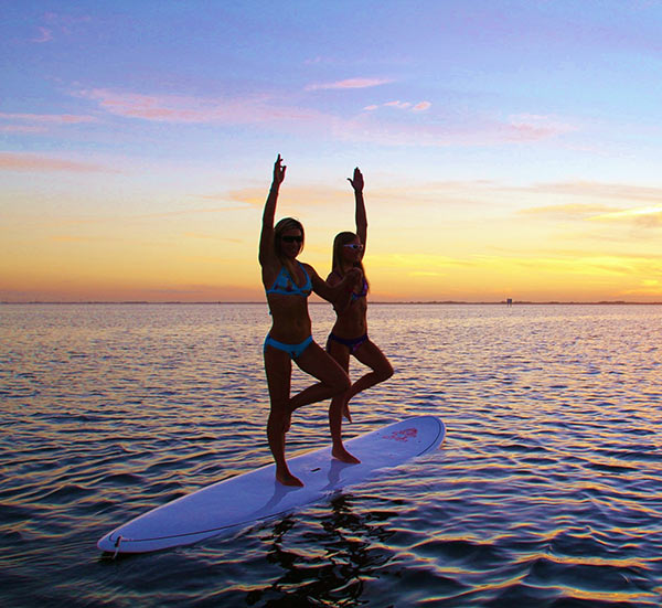 Harmony & Evey  2 trees in the Banana River,  Sunset yoga session Cocoa Beach, Florida     Photo Credit Dan Gavere