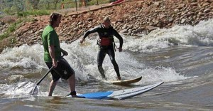 Dan Gavere SUP and Ken Hoeve short board the Glenwood wave, Colorado River.