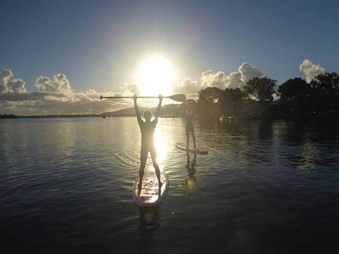 """Erica Hamp: """"We put our hands up ike the ceiling can't hold us"""" with Kelly Carthy at Kayak Noosa on the beautiful Noosa River, Australia."""