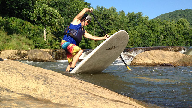 Pete Lucic: Local SUP ripper Barry Kennon pulls though a dynamic pivot turn in the ledge rapids near Dillsboro, Western North Carolina.