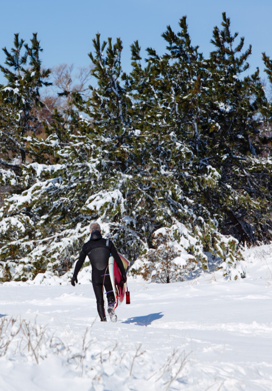 Travis Hayes New England winter sup surf tradition