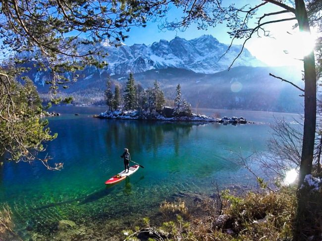 Girls on SUPs stand up paddling winter German Alps