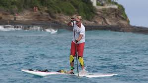 Dr. Bob Arnot stand up paddle