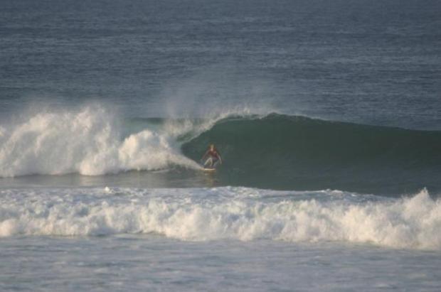 Reuben May surfing