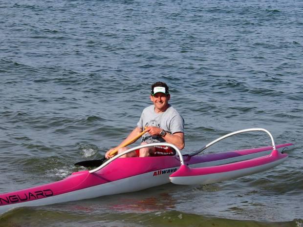 John Galilee pink OC1 paddling
