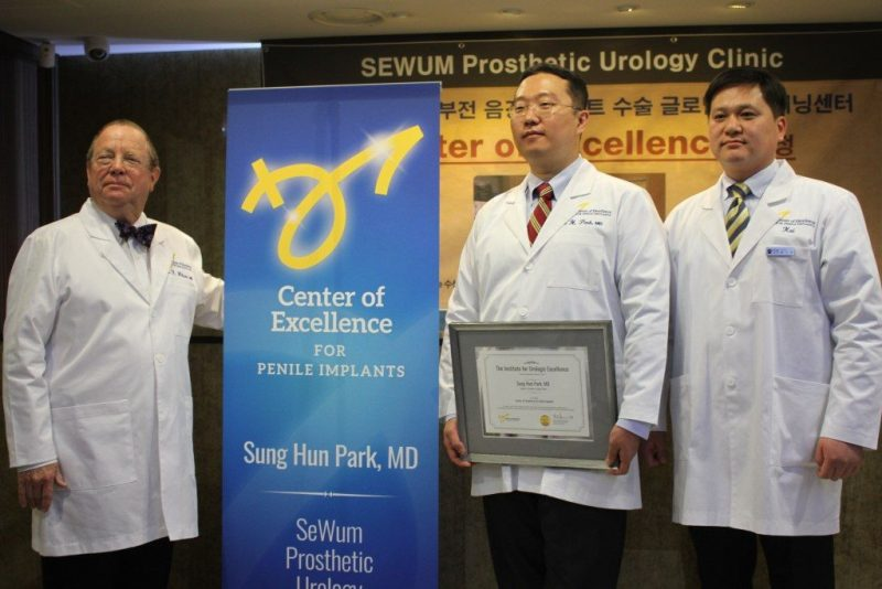 Dr. Wilson, Dr. Park, and staff at Penile Center of Excellence award ceremony