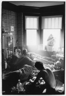 Hippies in room with light shining through window
