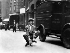 Cycle engineer riding the world's smallest bicycle through the city, London, August 1937
