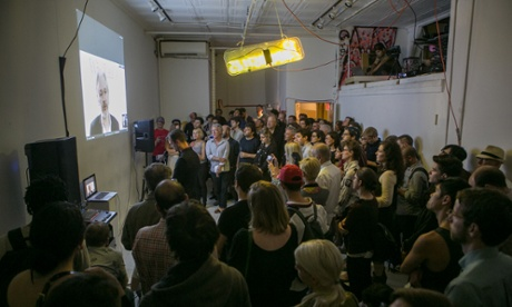 New Yorkers watch, drink beer, as Assange talks about the internet Photograph: OR Books/ Courtney Dudley Photography
