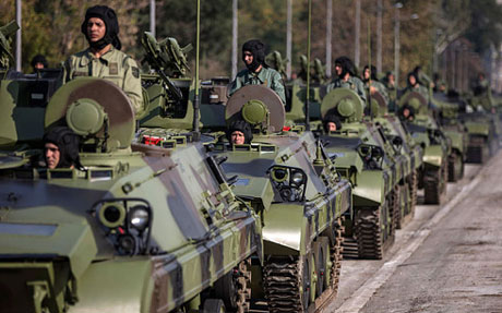 Serbian army soldiers drive tanks during preparations for a military parade in Belgrade Photo: Reuters