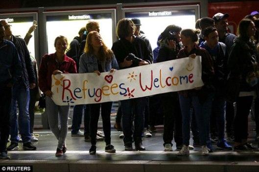 Добродошлица мигрантима на железничкој станици у Франкфурту