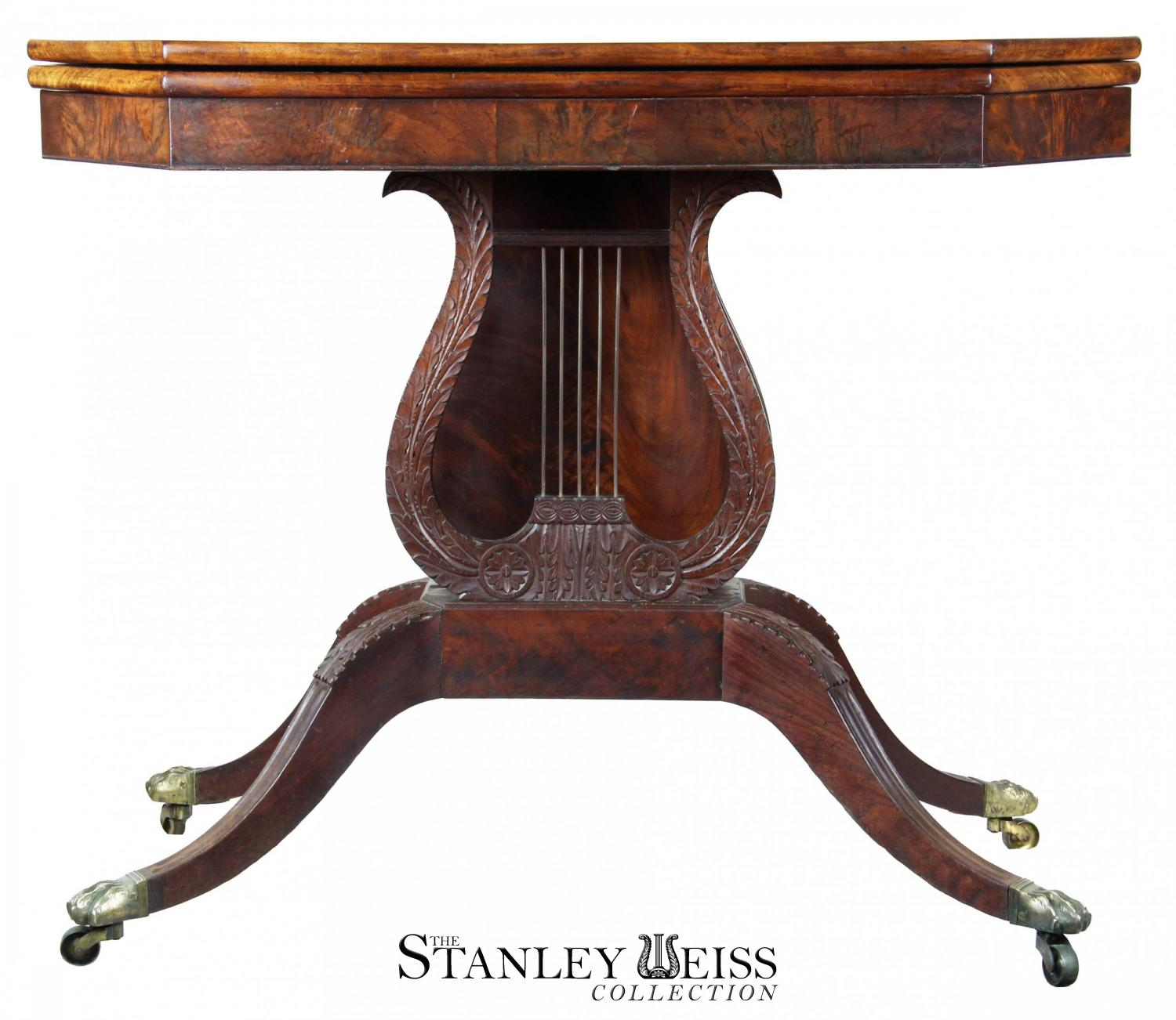 a carved mahogany card table with