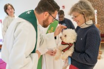 2016 Blessing of the Animals: James blesses Carol's dog