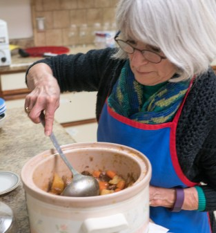 Carolyn Myracle stirs the contents of a crock pot.