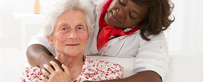 senior patient with friendly female nurse