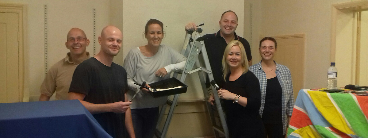 Stansted staff help paint offices at Fragile X Society, Great Dunmow