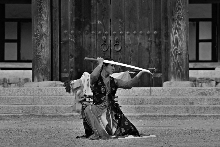 Image of an Asian woman holding a sword