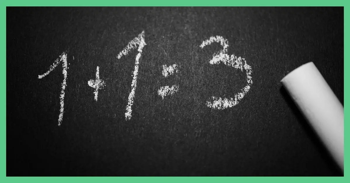 A sum on a blackboard written out in chalk that reads: '1+1 =3'. The image is being used in an article about thrifty living tips that people should avoid.
