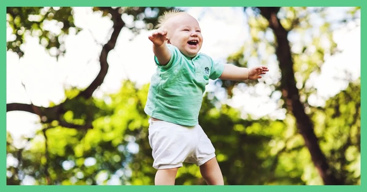 A happy toddler in a t-shirt. They are enjoying summer activities.