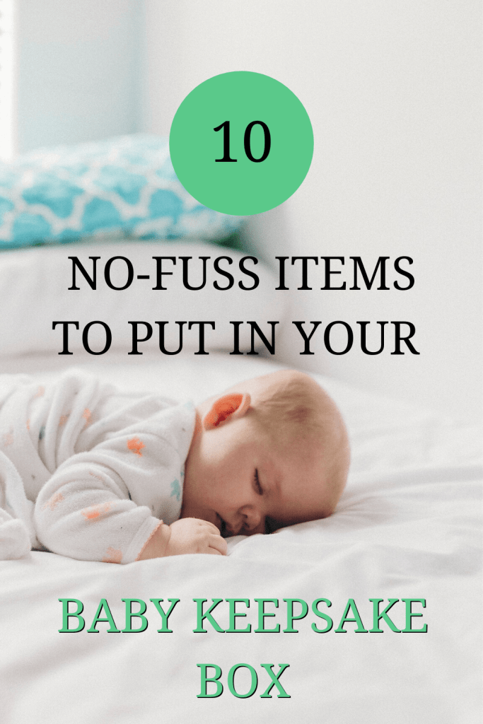 The image shows a baby asleep on a white sheet. Over the image the text reads: '10 no-fuss items to put in your baby keepsake box'.