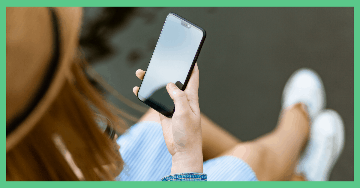 The image shows a woman on a smartphone. The picture has a green border.