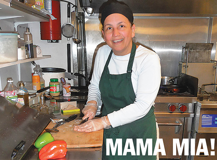 Diana Delima prepares vegetables for evening meals at Mama Leo's, one of Portland's few restaurants featuring Caribbean food. It's open Tuesday through Saturday, but the owners hope to expand to Sundays in mid-2014. (Janet Goetze)