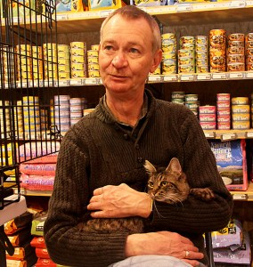 Kirk Kiggins, outreach coordinator with Animal Rescue and Care Fund, a local nonprofit organization, holds 8-year-old tabby cat named Sandy at an adoption event sponsored by Furever Pets, 1902 N.E. Broadway.