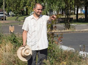 Green King Project founder Diego Gioseffi stands in the bioswale next to the King School parking lot. (Judy Nelson)