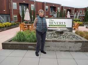 In warmer weather, Beverly resident Pat Knott enjoys visiting with neighbors in the Beverly's courtyard, which includes a communal gas grill and vegetable garden.