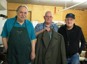 Calaroga Terrace's Treasure Box volunteers Steve and Glen, left, stand with 90-year-old WWII Veteran John Anthony, who's ready to sell the well-made wool coat he's owned since 1941 when he enlisted in the Marine Corps. (Kathy Eaton)