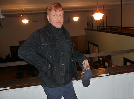 "Randall Stuart, long active in theaters, sees a community arts and humanities center forming in a 1924 Masonic temple. A balcony overlooks a large gathering room. Artists come to Portland because, he says, ""It is a dynamic think-tank these days. (Janet Goetze)"