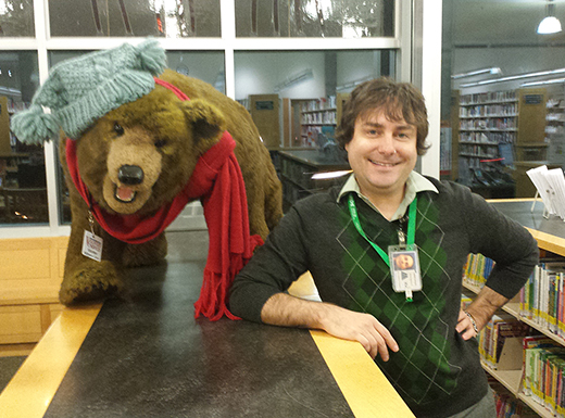 Library Assistant Christopher Cuttone has served Multnomah County Library patrons for 15 years. He feels most gratified when he gets kids hooked on reading. (MaryGrace McGovern)