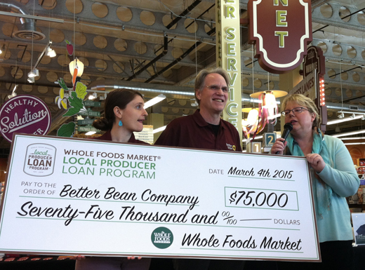 Hannah and Keith Kullberg, left, are presented with a $75,000 check by Denise Breyley, Whole Foods Market's Local Forager, during an event at the natural grocer's Hollywood store. (Ted Perkins)