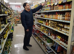 "La Bouffe, named after a French slang term for ""food,"" is an international gourmet shop on Southeast Stark Street. Manager Bader Hamieh stocks the shelves with a variety of food products, including locally produced items."