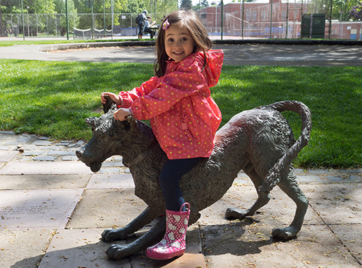Charlotte Nesse, who recently moved to Portland from San Francisco, enjoys riding Ribsy, one of the Beverly Cleary statues in Grant Park.