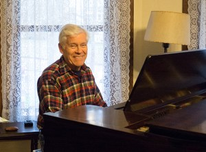 Alameda resident and union musician Jim Brown learned to play piano at age six. He sits at the 100-year-old Knabe piano in the living room of the home where he's lived for 35 years. The piano has been rebuilt over the years, but retains its original finish.