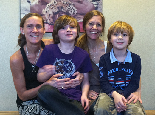 Gretchen Olsen, left, and Danelle Denstone (pictured with their sons Vaughn and Ethan) are the new co-owners of Bikram Yoga Fremont Street, behind Pizza Nostra in Beaumont Village. (Jane Perkins)