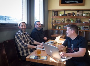 Abe, Ben, and Justin meet at Martha's, located inside the former Washington High School's southwest corner. The cafe is operated by Revolution Hall, serving meals daily, and offering revolutionary happy hour deals from 4-6 p.m. (Judy Nelson)