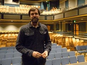 Ned Failing, house manager for Revolution Hall, said the sound system is the best in Portland for a venue this size. Failing stands on stage at the renovated auditorium, which includes new balcony seats that accommodate today's adults. (Judy Nelson)